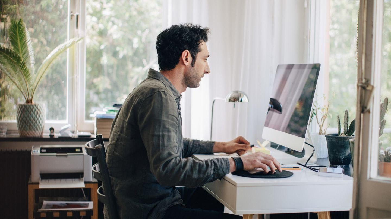 man on computer researching internet speeds