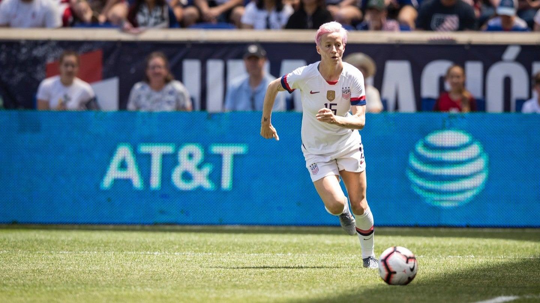 Photograph of Megan Rapinoe dribbling a soccer ball