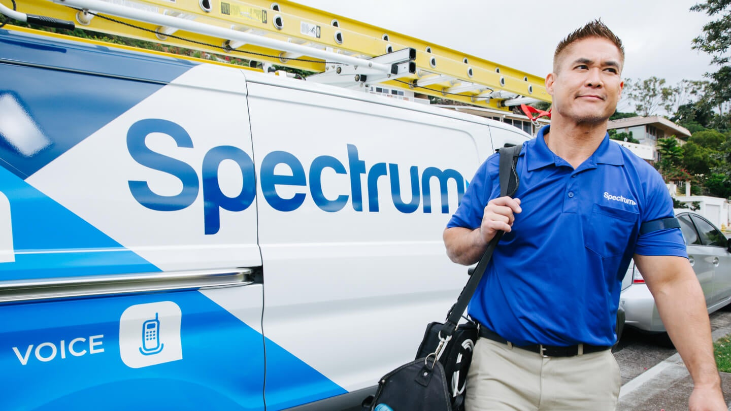 Photo of Spectrum service truck and technician