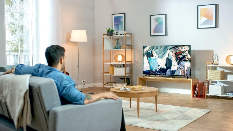 Image of a man watching TV
