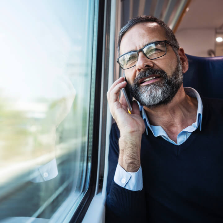 Man using his cell phone while on a train