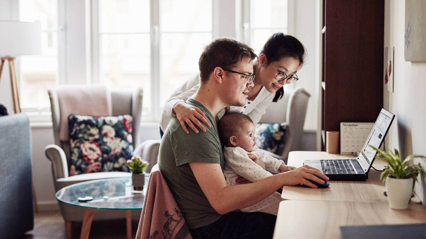 Family looking at computer