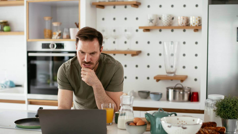 Man reading news on computer