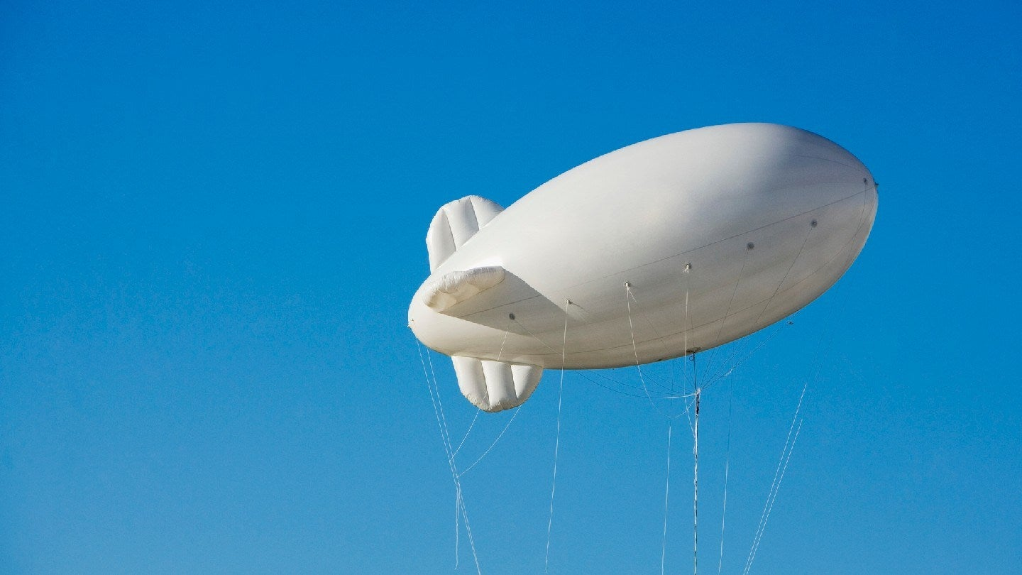 Low angle view of a blimp in the sky - stock photo