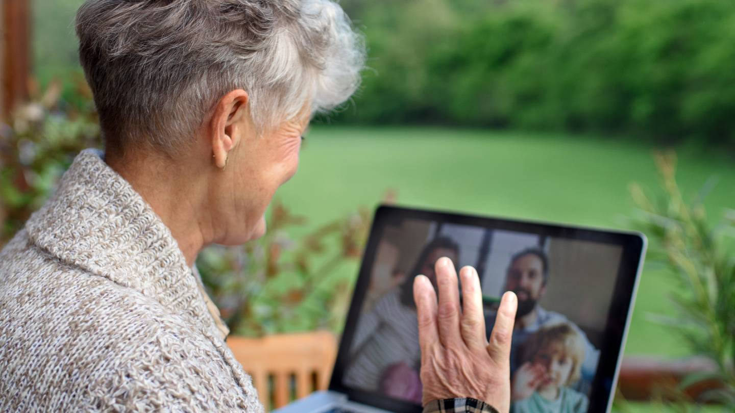 Woman video chats with family