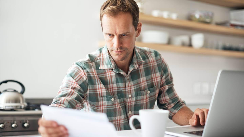 Man looking at his finances