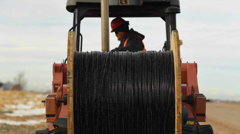 Man deploying fiber cable