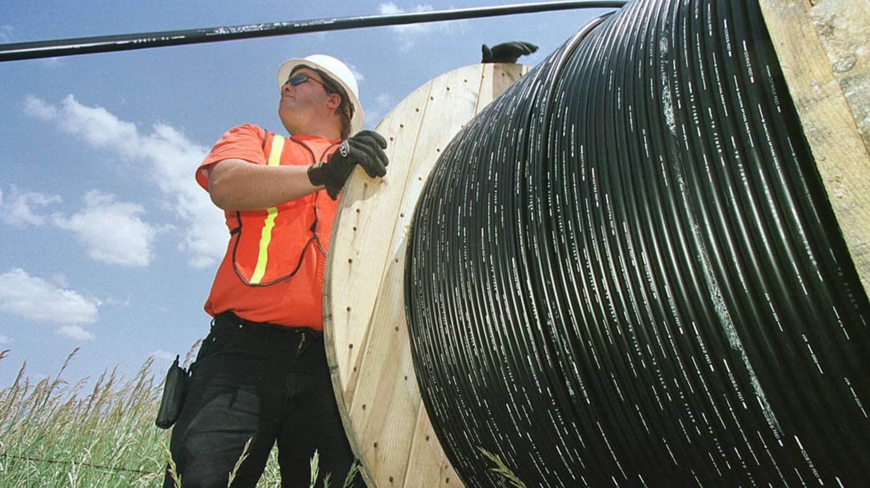 Man deploying fiber optic outdoors