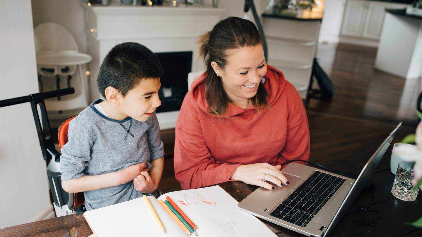 mother and son with autism looking at computer