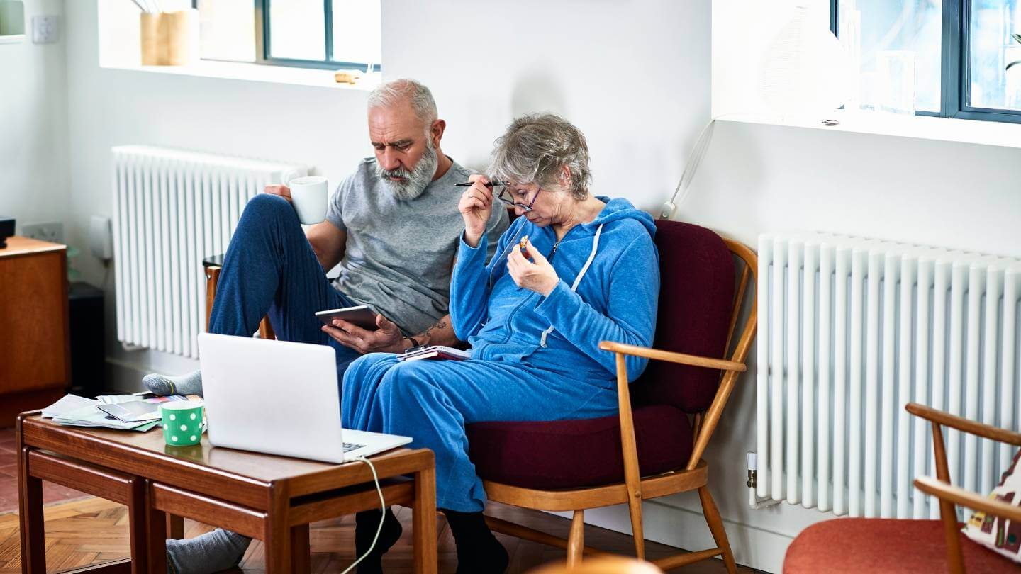 Elderly couple looking confused at computer