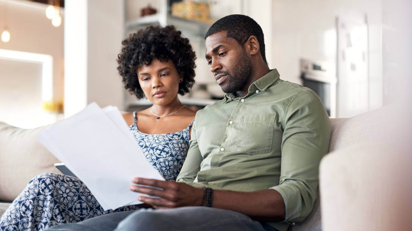 Couple looking over paperwork for their internet service