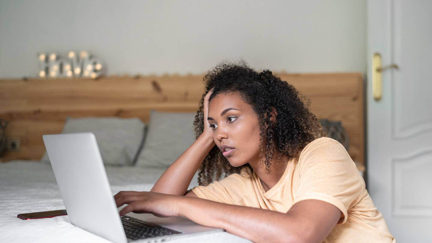 Woman looking stressed while online