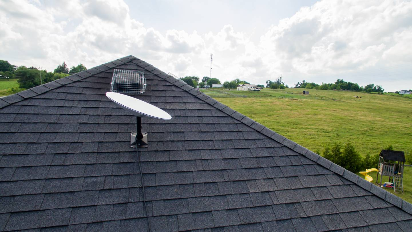 Starlink satellite on the roof of a rural home.