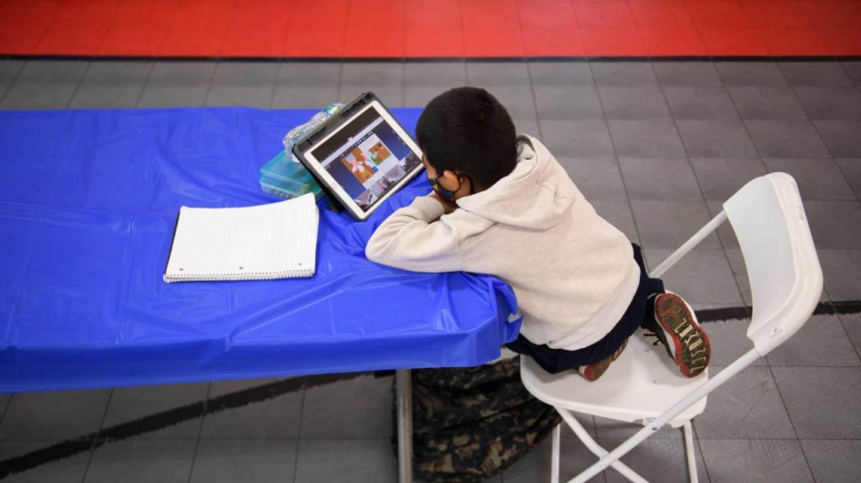 Boy doing homework in a public location